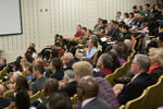 Conference attendees listen attentively to the Saturday presentations