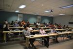 Conference attendees enjoy a presentation by Sarah Burton