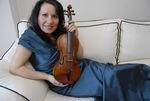 Violin Duo Performs on Campus