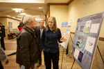 Physics professor Tiffany Summerscales explains her research to College of Arts and Sciences Dean, Keith Mattingly