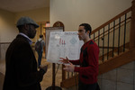 "Graduate student Rodrigo de Galiza Barbosa (right) explains his poster ""Projections and prophecies - the 2010 Brazilian Census and SDA Eschatology"""