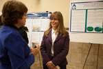"""Physical Therapy professor Kimberly Ferreira (right) discusses her poster """"actors Influencing the Enrollment of Clinical Instructors in the APTA Credentialed Clinical Instructor Program: Perspectives of the APTA Credentialed Trainers"""""""