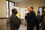 Biology professor David Mbungu (left) discusses his research with Biology professor emeritus John Stout (right)