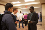 Chemistry professor Getahun Merga (right) explains his poster to interested undergraduate students