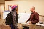 Engineering and Computer Science professor Rodney Summerscales (right) explains his poster to undergraduate student Belinda Cheeseboro