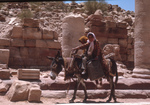 Petra-MainS treet-Two Bedouin On Donkey by Larry Mitchel