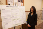 "Honors Scholar Michelle Imperio poses beside her poster ""Synthesis and Spectroscopic Studies of Chalbenes"" by Andrews University"