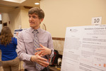"Honors Scholar Stephen Erich explains his poster ""The Effect of Mandatory Corporate Social Responsibility on Share Returns in Indonesia"""