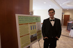 "Undergraduate Research Scholar Trevor Zimmerman poses beside his poster ""Field documentation of summer and fall diet in thirteen-lined ground squirrels, Ictidomys tridecemlineatus"""
