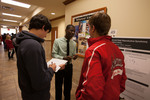 "Wadenerson Saint Martin (middle) presents his poster ""The Relationship Between Yearly and Daily Reproductive Synchrony"""
