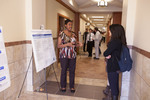 "Belinda Cheeseboro (left) explains her poster ""Accessing Information Using LVAlert and Python"""