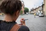 Student Sketching Street Scene in Torre Pellice by Troy Homenchuk